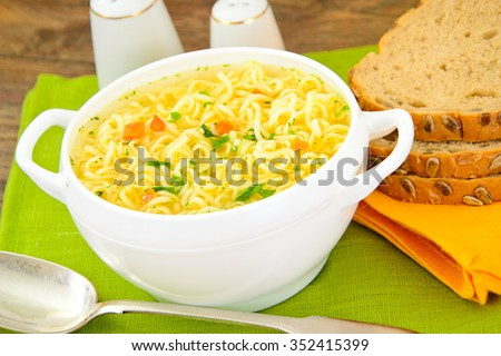 Tasty Chicken Soup with Noodles. Studio Photo - stock photo