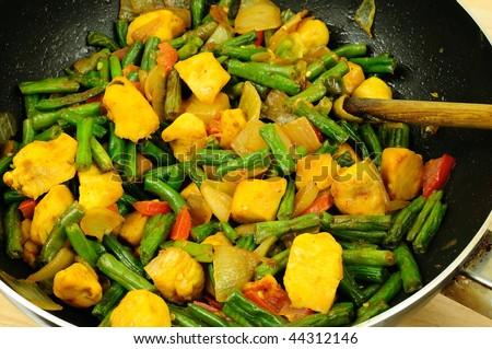 Tasty chicken with string green beans stir fry preparation - stock photo