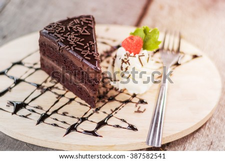 Tasty chocolate cake with berries on table close up, Chocolate Cake, Chocolate. - stock photo