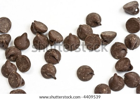 tasty chocolate chips on a white background - stock photo