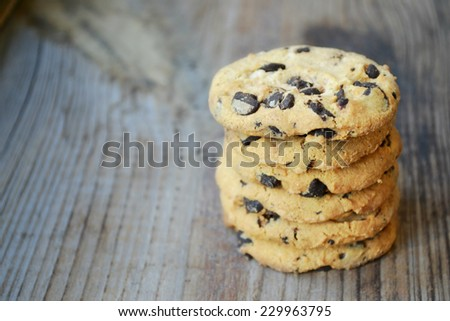 Tasty chocolate cookies on wooden table - stock photo