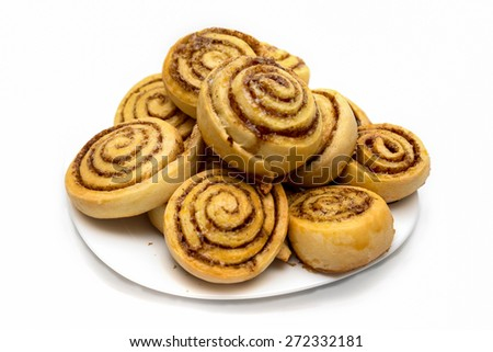 tasty cinnamon rolls on a dish isolated on white - stock photo