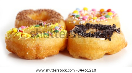 Tasty colorful donuts against white background - stock photo