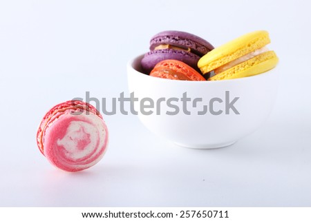 tasty colorful macarons on white background - stock photo
