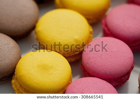 Tasty colorful macaroon - yellow, pink, green, beige. - stock photo