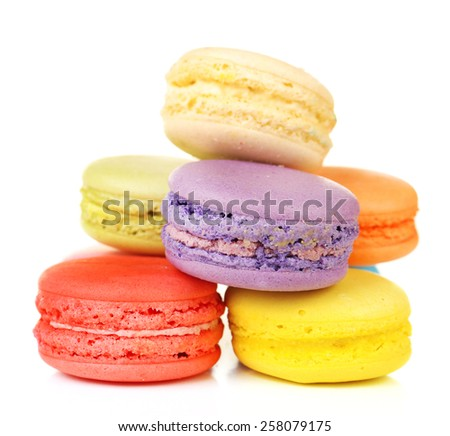 Tasty colorful macaroons isolated on white - stock photo