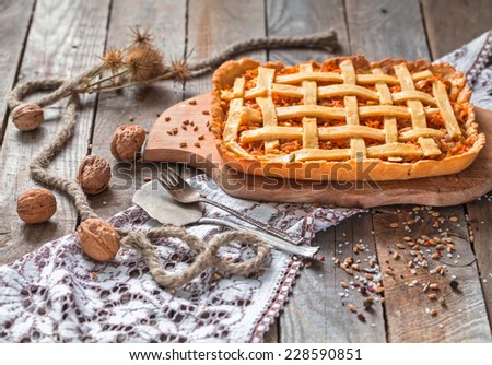 Tasty composition of salty chicken pie served on a wooden cutting board. - stock photo