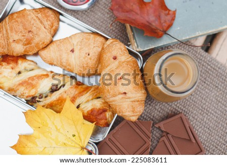 Tasty composition with french croissants, cappuccino and chocolate. - stock photo