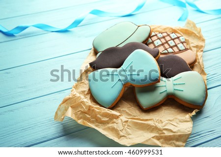 Tasty cookies on blue  wooden background