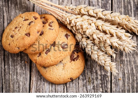 Tasty cookies with wheat on a wooden table. - stock photo