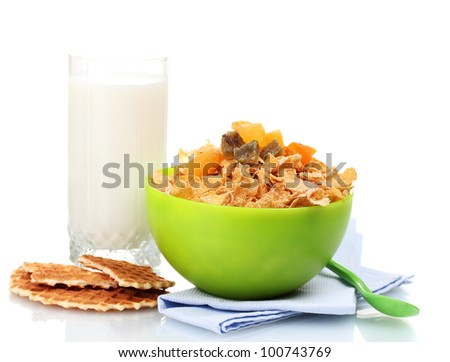 tasty cornflakes in green bowl and glass of milk isolated on white - stock photo