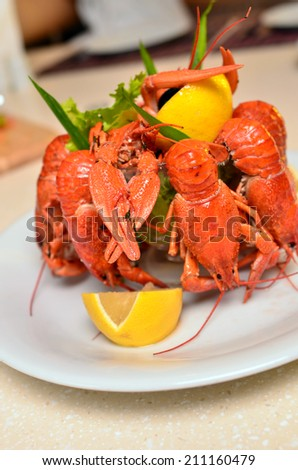 Tasty crayfish served with lemon - stock photo