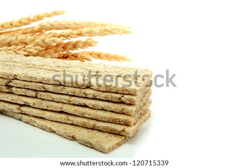 tasty crispbread and ears, isolated on white - stock photo