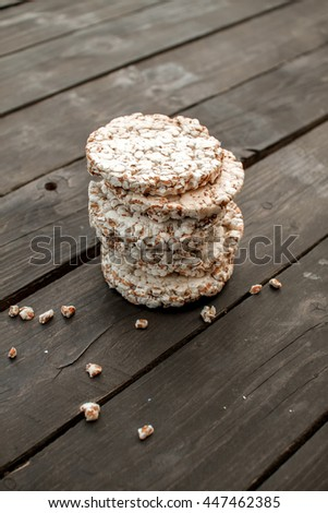 tasty crispbread on wooden background table, spilled milk and crumbs. close up - stock photo