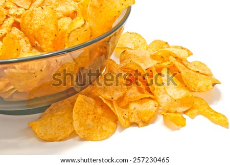 tasty crispy potato chips closeup on white background  - stock photo