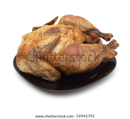 Tasty Crispy Roast Chicken on black plate . - stock photo