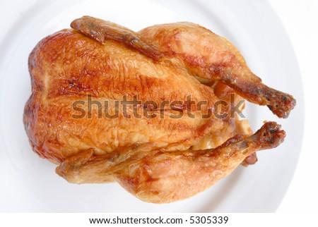 Tasty Crispy Roast Chicken on white plate . - stock photo