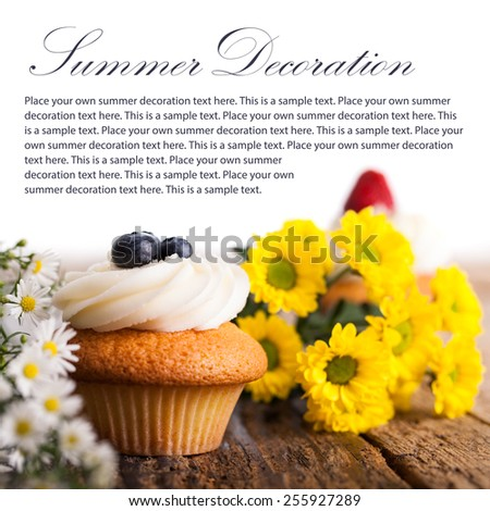 tasty cupcake and flowers with example text - stock photo