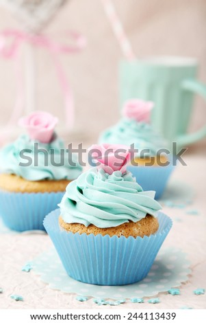 Tasty cupcake on pink background - stock photo