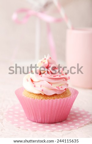Tasty cupcake on pink background