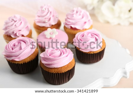 Tasty cupcakes on stand, close-up - stock photo