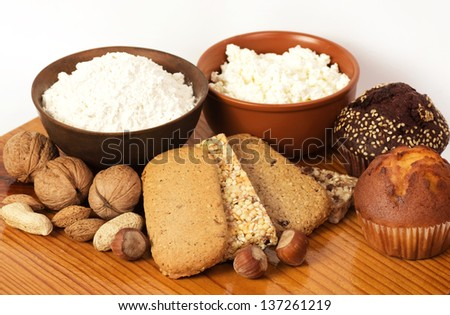 Tasty curd cheese, nuts and musli bars. Healthy food - stock photo