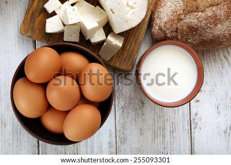 Tasty dairy products with bread on table close up - stock photo