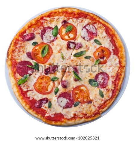 Tasty deluxe pizza from the top on white background - stock photo