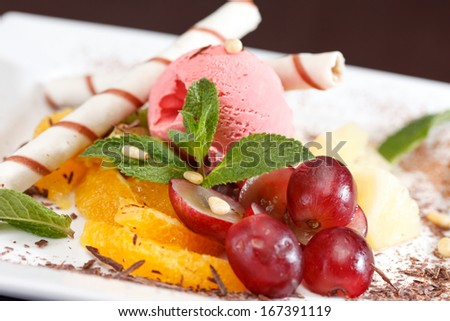 tasty dessert with ice cream and fruits - stock photo