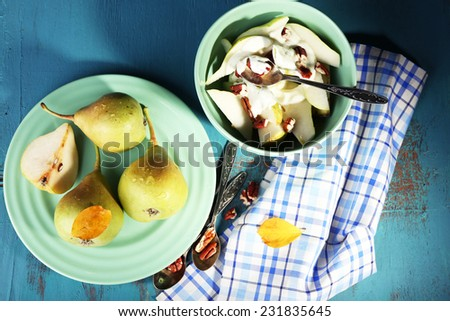 Tasty dessert with pears and fresh pears, on wooden table - stock photo