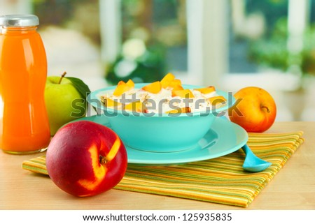 tasty dieting food and bottle of juice, on wooden table - stock photo