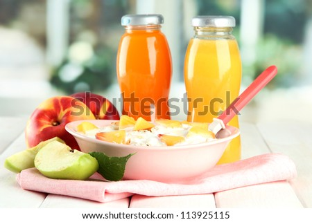 tasty dieting food and bottles of juice, on wooden table - stock photo