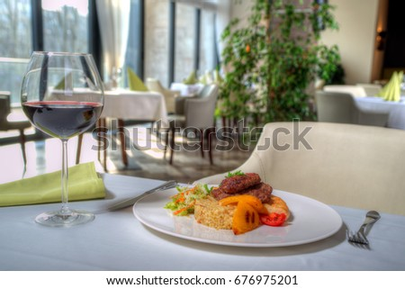 tasty dish with garnish and meat in the restaurant