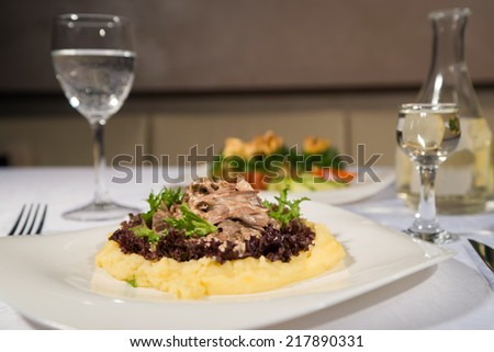 tasty dish with mushrooms and vodka in a restaurant
