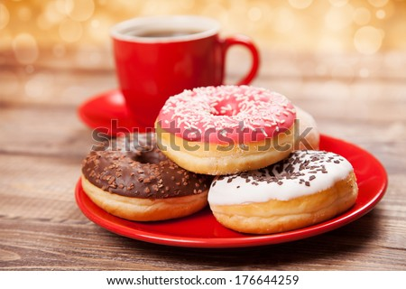 Tasty donut with a cup of coffee - stock photo