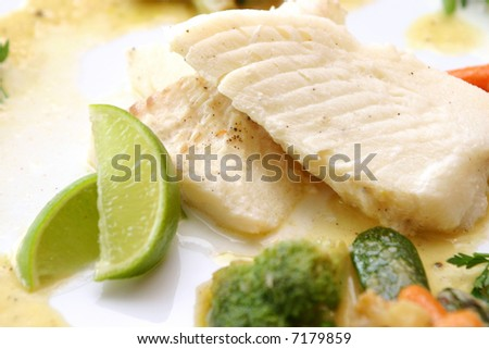 Tasty fish with lime - stock photo