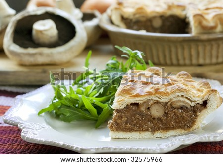 Tasty, flaky, mushroom pie, with rocket salad. Delicious homely ...