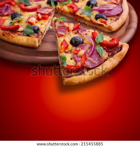 Tasty, flavorful pizza isolated on red background  - stock photo