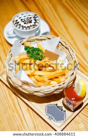 Tasty french fries with ketchup and coffee