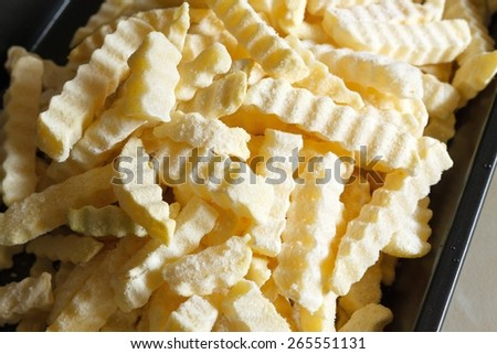 Tasty french frites close up with natural daylight, fast food concept - stock photo