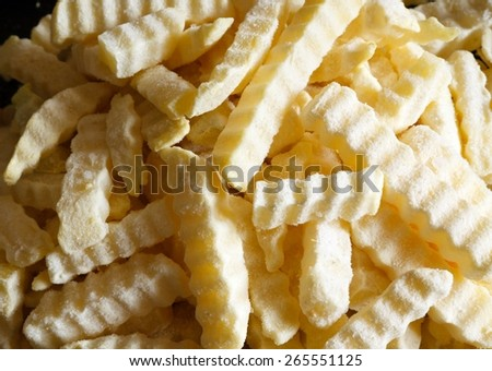 Tasty french frties close up with natural daylight  - stock photo