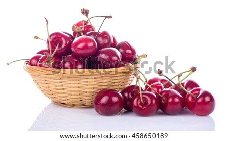 Tasty fresh cherries in a basket, isolated on white
