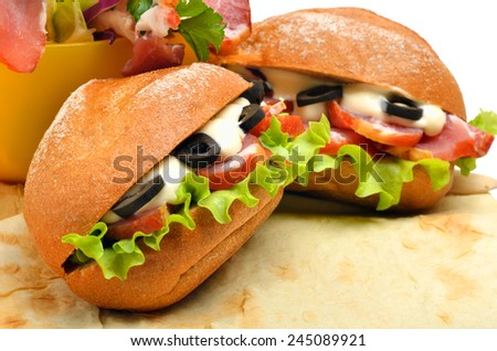 Tasty fresh sandwiches with green lettuce, ham and olives on lavash  isolated on white - stock photo