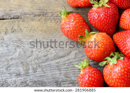 Tasty fresh Strawberries on the wooden background - stock photo