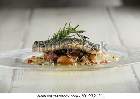 tasty fried fish with mashed potato  on bright background - stock photo