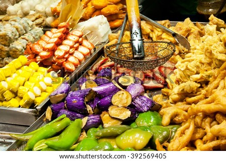 Tasty fried food on a street kitchen in Asia. Fresh vegetables, meat and fish. Hong Kong, China.  - stock photo