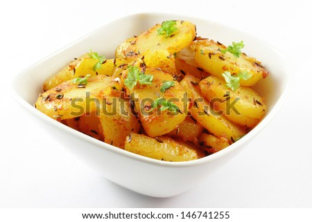 tasty fried potatoes with parsley and caraway. - stock photo