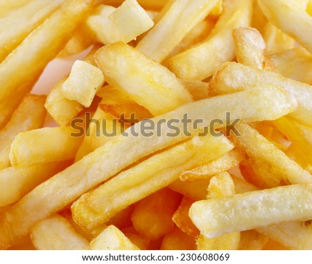 tasty fries photographed close-up on white background