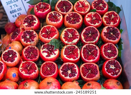 Tasty garnets at a farmers market - stock photo