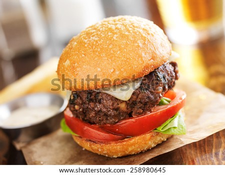 tasty gourmet burger with french fries in slanted composition - stock photo